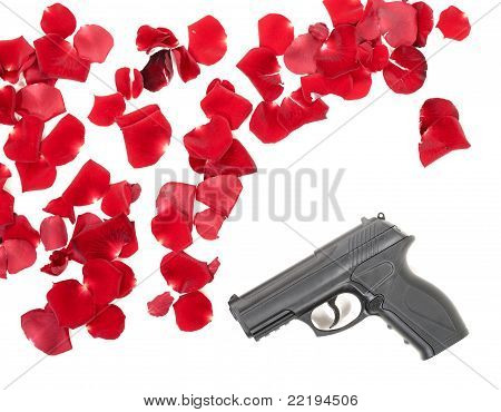 Gun Between The Rose Petas