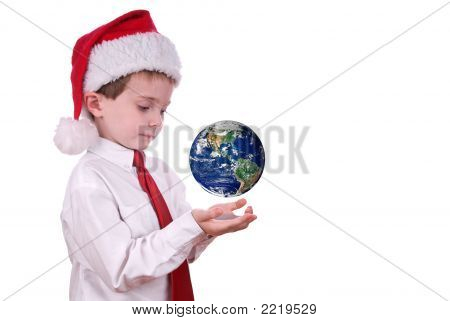 Boy In Christmas Hat With Earth