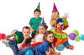 Birthday child clown playing with children and bunny fingers prank. Kid posing for photo and smiling poster
