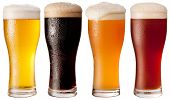 Four glasses with different beers on a white background. The file contains a path to cut.