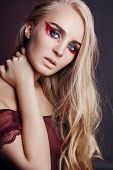 Art Beauty Nude Woman In A Red Bodysuit, Perfect Makeup On Her Face. Blonde With Perfect Long Hair P poster
