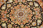 stock photo of tabriz  - beautiful medallion pattern on a persian carpet fron tabriz iran - JPG