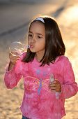 pic of have sweet dreams  - Girl has a good time playing outside late in the afternoon - JPG