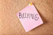 Note with word Bullying pinned to board poster