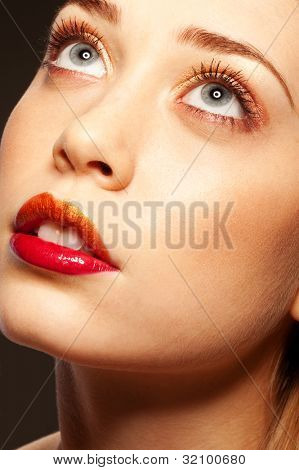 Pretty blonde girl with parted lips looking up beseechingly for heavenly help