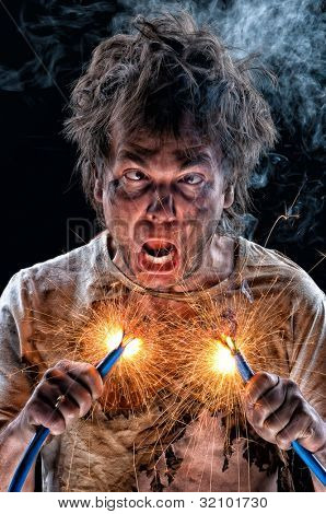 Portrait of crazy electrician over black background