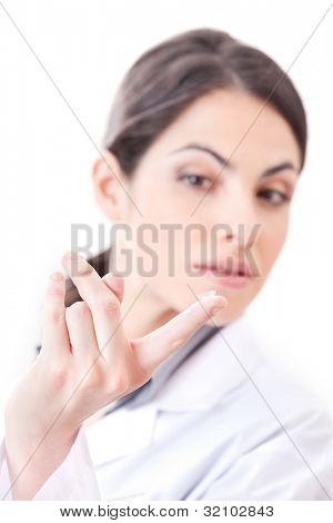 Optometrist holding contact lens in finger.
