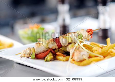 grill meat bbq and vegetable on stick prepare in kitchen at restaurant