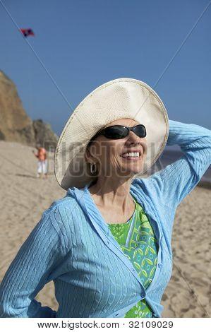 Woman Enjoying Sunlight on Her Face at Beach