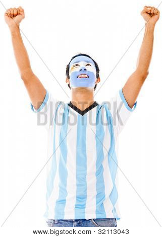 Excited Argentinean man with arms up celebrating - isolated over white