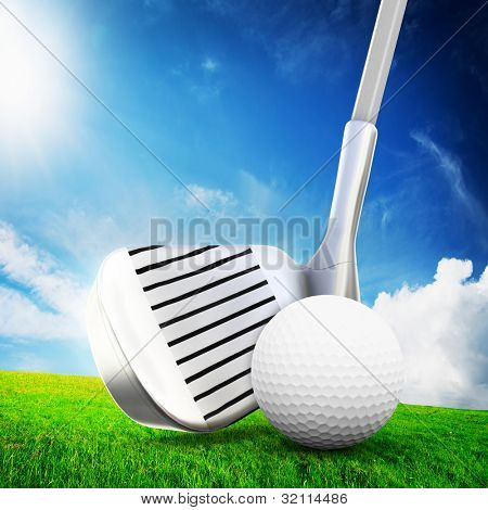 Playing golf. Ball, a golf club ready to shot. Sunny summer scene