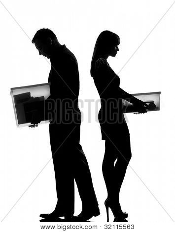 one caucasian couple man and woman in studio silhouette isolated on white background