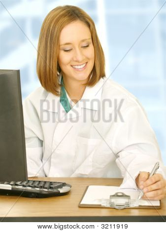 Doctor Woman Working On Her Desk