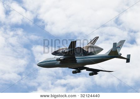 Space Shuttle Discovery, Mounted On The Shuttle Carrier Aircraft, Flying Over The Washington, D.c. A