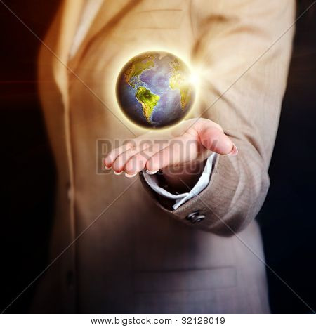 Business Woman Holding Earth Globe In Her Hand