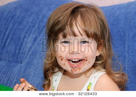 The Little Girl Eats A Cake