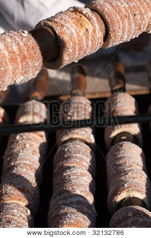 Trdelnik Sweet Pastry Stall At The Traditional Christmas Market In Prague, Czech Republic