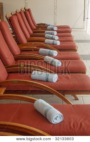 Orange Chaise Lounges With Blue Towels