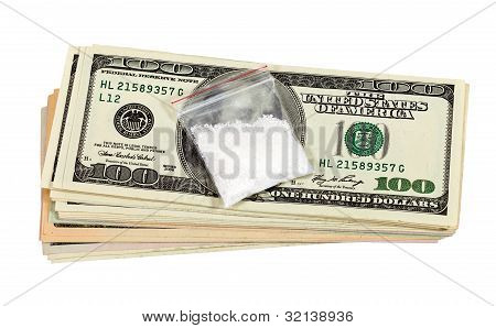 Package With  Drug Against The U.s. Dollars Bills. Isolated On White Background.