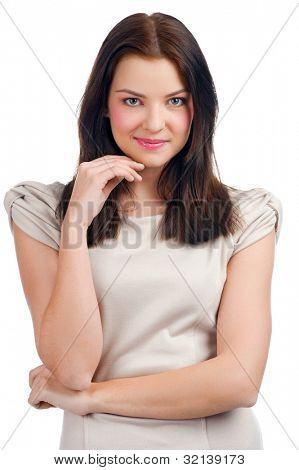 Portrait of lovely young pensive woman touching her chin, against white background