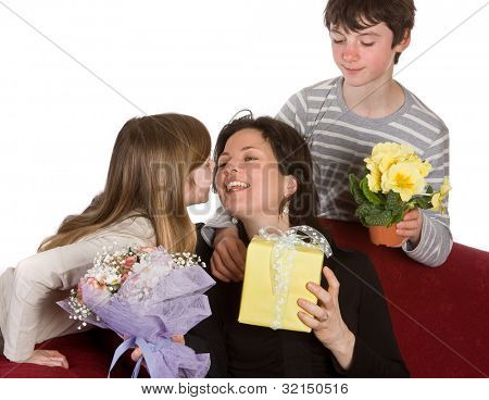 Boy and girl hugging their mother on mother's day