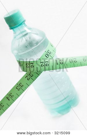 Bottle of mineral water with measuring tape