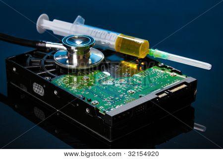 Stethoscope on hard disk drive on dark blue background