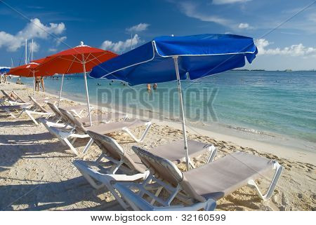 Beach Umbrellas And Chairs In Cancun, Mexico