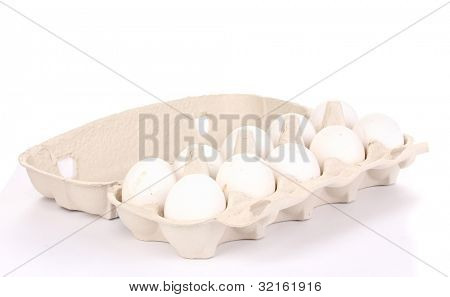 Eggs in paper box isolated on white
