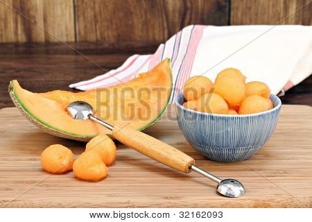 Cantaloupe Melon Balls In A Bowl With Selective Focus On Fruit In Bowl.