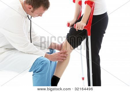 Orthopaedic Surgeon Examining Woman's Knee