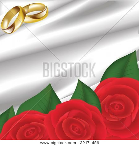 gold wedding rings with red roses on white silk