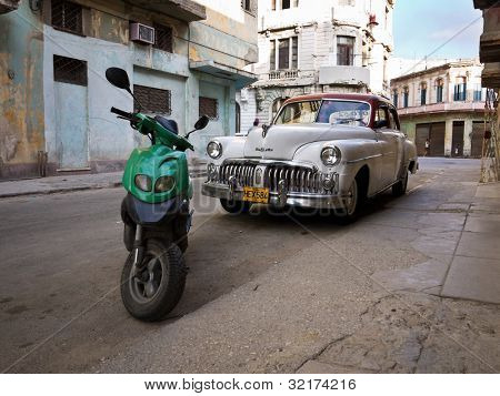 HAVANA-APRIL 15:Classic DeSoto in a shabby neighborhood in Old Havana April 15,2012 in Havana.Before a new law issued on October 2011,cubans could only trade cars that were on the road before 1959
