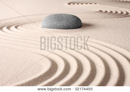 meditation concentration and spa relaxation zen buddhism spiritual japanese rock garden abstract harmony and balance concept for purity sand and stone
