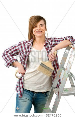 Friendly Female Painter With Paint Brush.