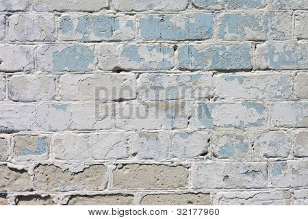 white textured brick wall painted