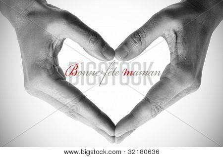 hands forming a heart and the sentence bonne fete maman, happy mothers day in french