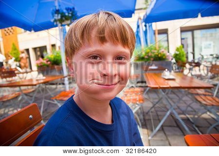Happy Child Smiles With Full Mouth And Looks Boldfaced And Laughs