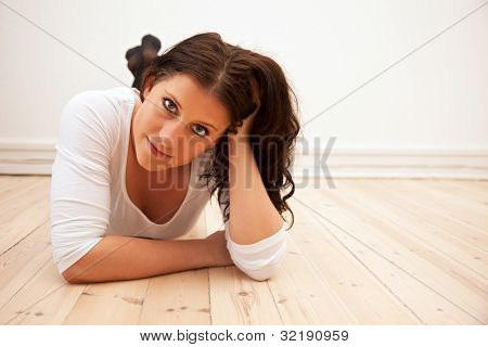 Woman Lying On The Floor At Home