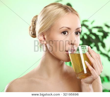Beautifu and youngl blonde with cup of green hot tea
