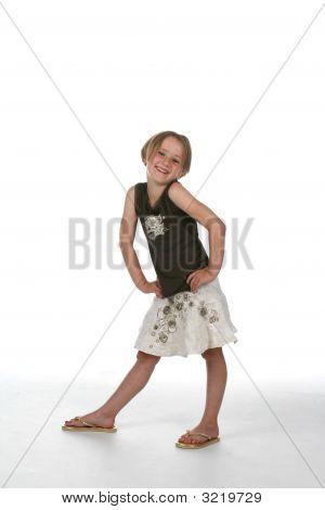 Shoulder Shrugging Girl With Hands On Her Hips