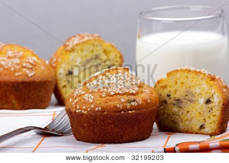 Corn flour muffins with mushrooms (champignons), cheese and sesame seeds