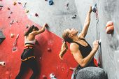Athletes Climber Moving Up On Steep Rock, Climbing On Artificial Wall Indoors. Extreme Sports And Bo poster