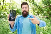 Best Gps And Navigation Apps. Man Bearded Wanderer Walking In Forest With Navigation Application. Us poster