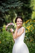 Emotional Portrait Of A Happy Bride In Fashion Wedding Dress On Natural Background. Newlywed With A  poster