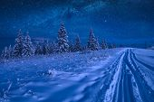 Winter In Carpathian Mountains. Bright Milky Way In A Sky. Colorful Night Landscape In The Highlands poster