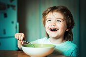 Kid Eating. Little Boy Having Breakfast In The Kitchen. Smiling Happy Adorable Baby Eating Fruit Mas poster