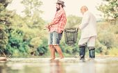 Hobby And Recreation. Success. Granddad And Drandson Fishing. Retired Businessman. Male Friendship.  poster