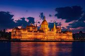 Budapest Parliament Building And Danube River At Night With Illumination, Travel Sightseeing Backgro poster