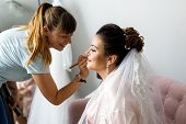 Bride Morning. Wedding Preparations. Makeup Artist Makes A Bride Makeup poster